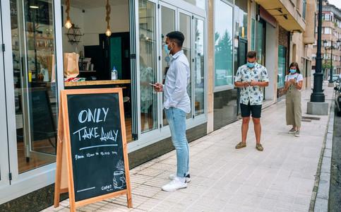 People waiting to buy take away food