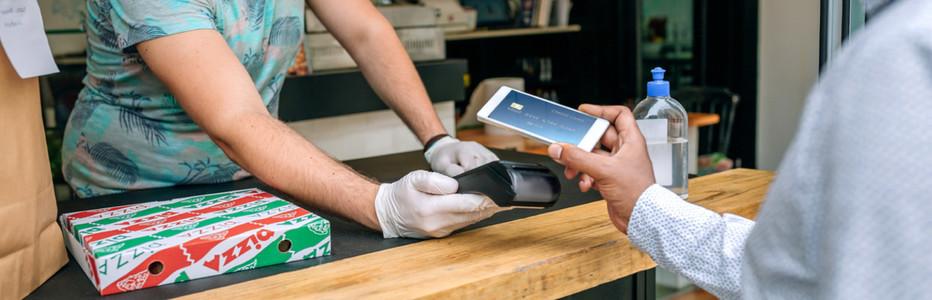Man paying with mobile a take away food order
