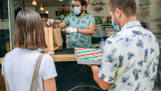 Couple picking up take away food order