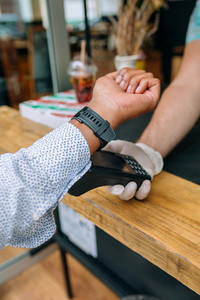 Unrecognizable man paying with smartwatch