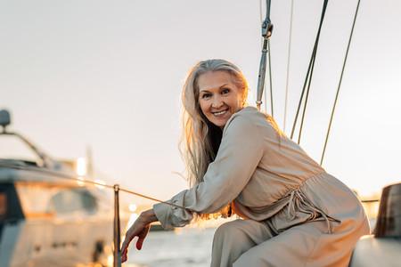 Cheerful mature woman sitting
