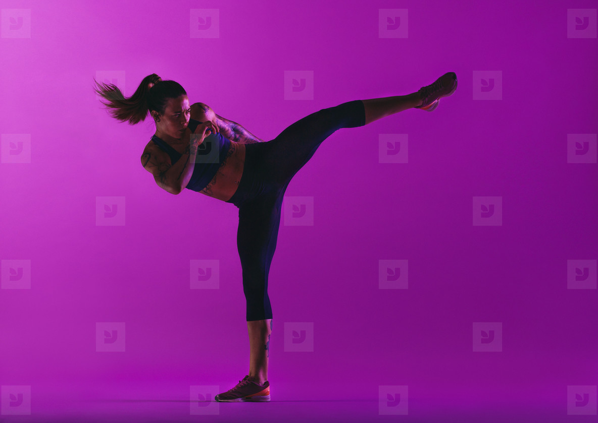 Woman athlete practicing martial arts