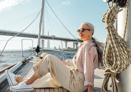 Stylish mature woman sitting