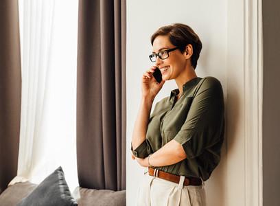 Caucasian businesswoman leaning