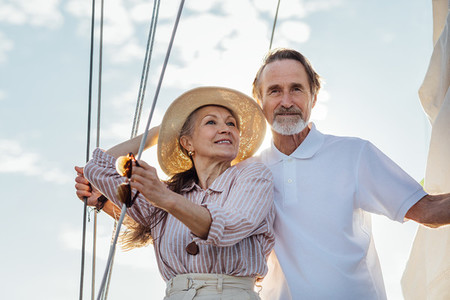 Mature couple standing on yacht