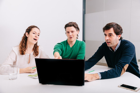 Group of office workers at a meeting around the boss