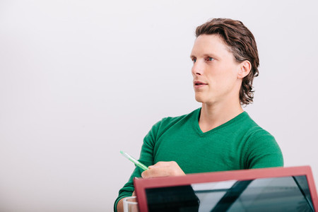 Close up of office worker sitting with green jersey