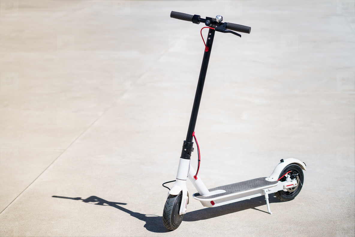 White Electric scooter eco alternative transport concept