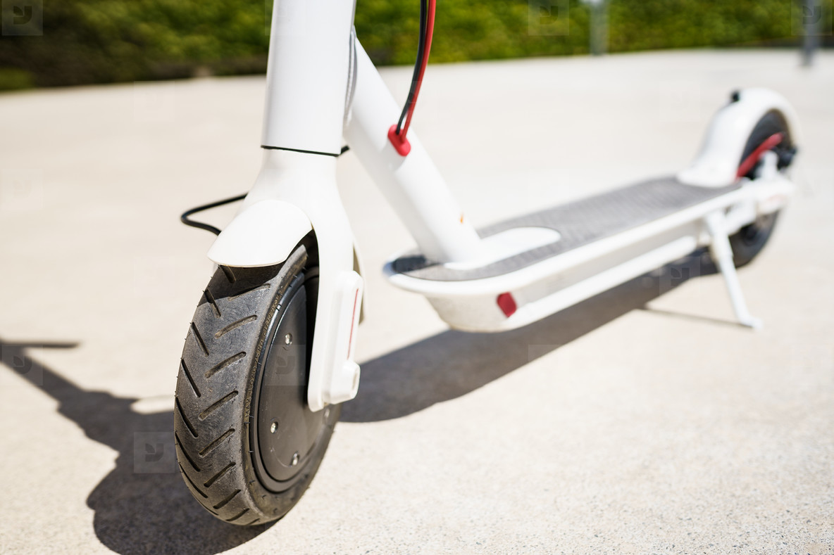 Detail of white Electric scooter eco alternative transport concept