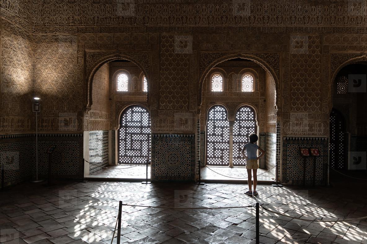 Girl enjoying the light of the Alhambra in Granada