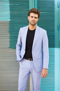 Attractive man wearing suit standing in urban background