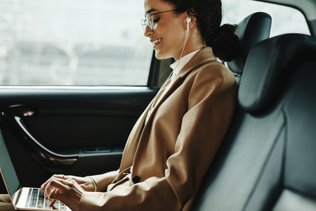 Businesswoman going to work in her car