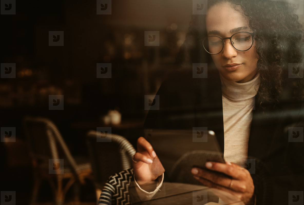 Businesswoman at a cafe using digital tablet