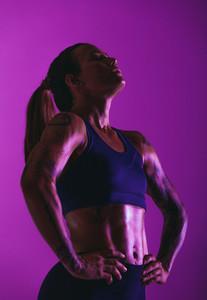Monochrome portrait of fit muscular woman