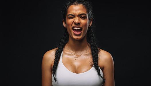 Portrait of fit woman making faces