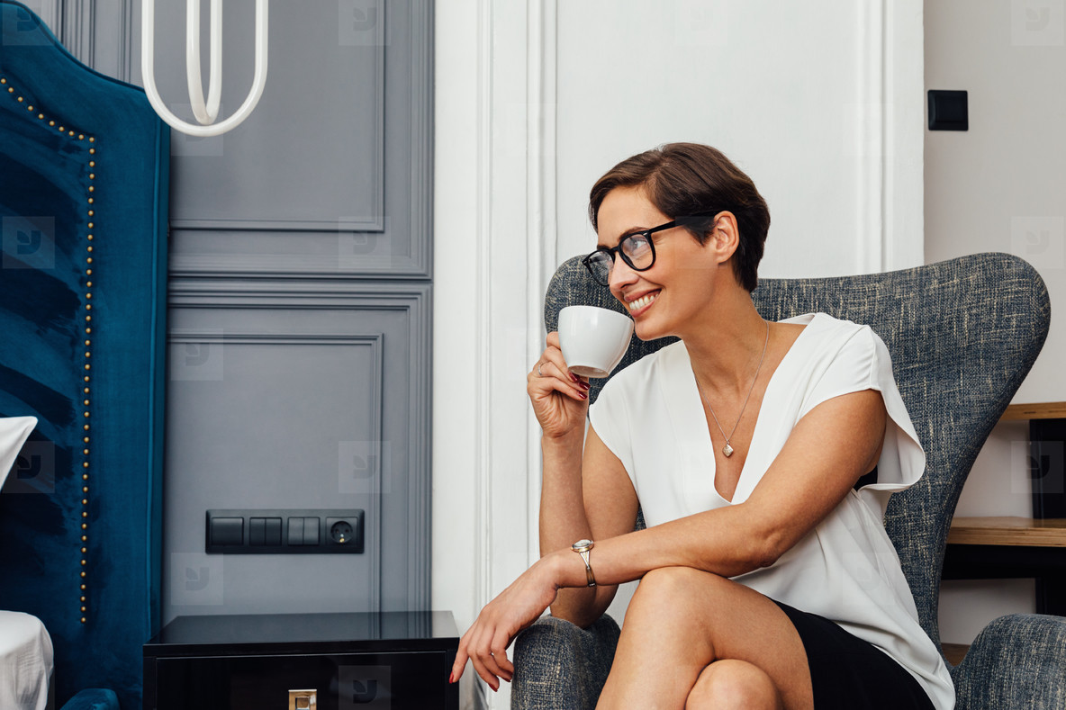 Smiling woman in casuals sitting