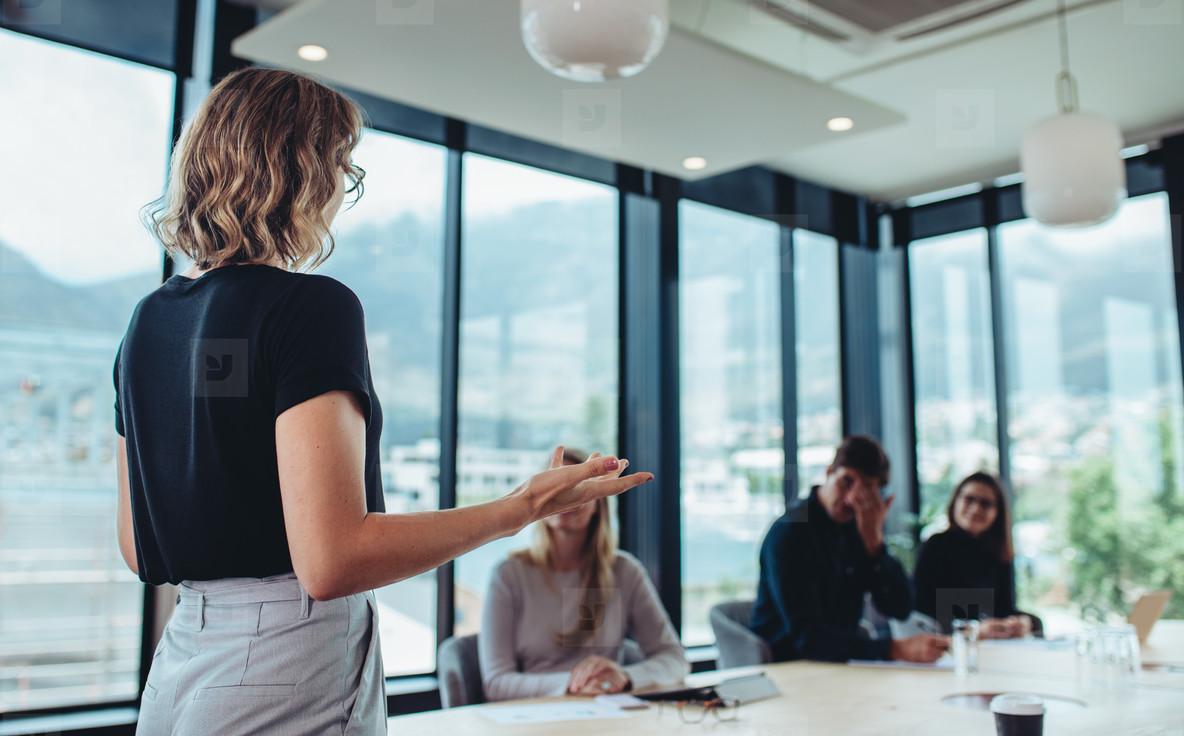 Female entrepreneur making a presentation at work