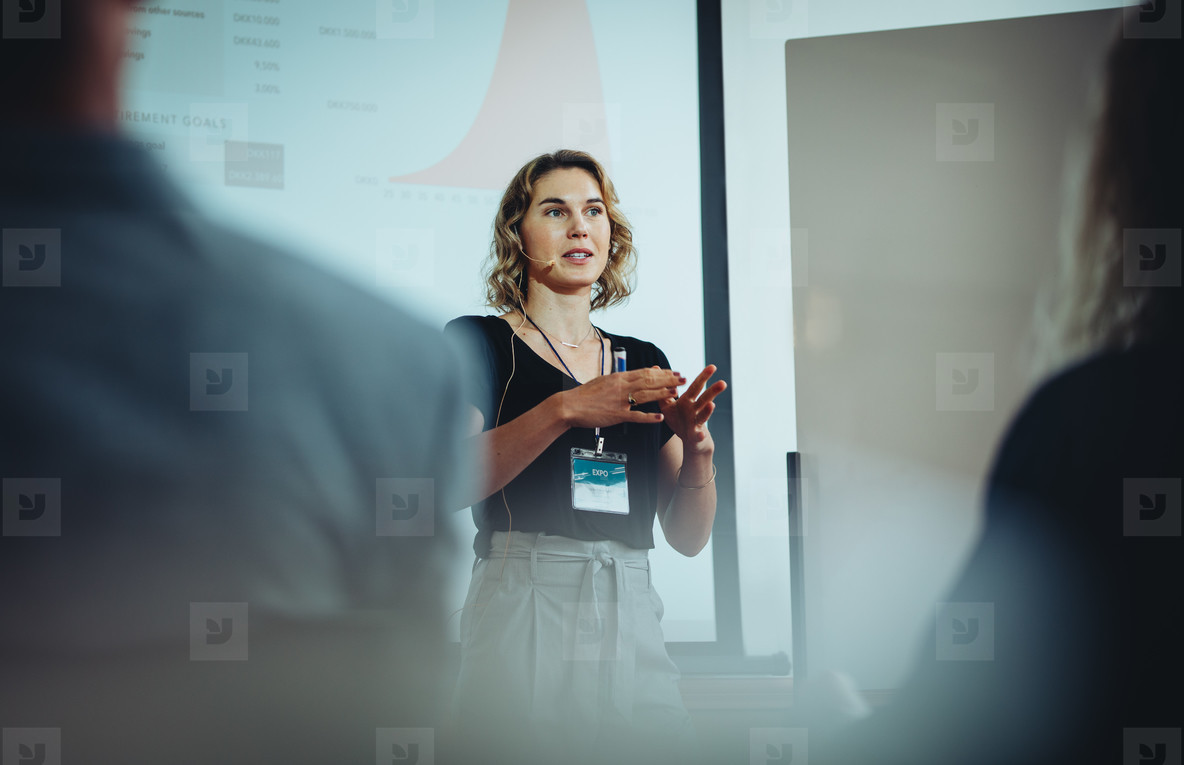 Entrepreneur discussing business ideas in a conference