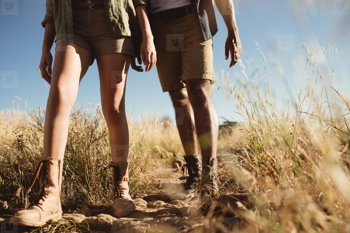 Hiker couple walking on rough terrain