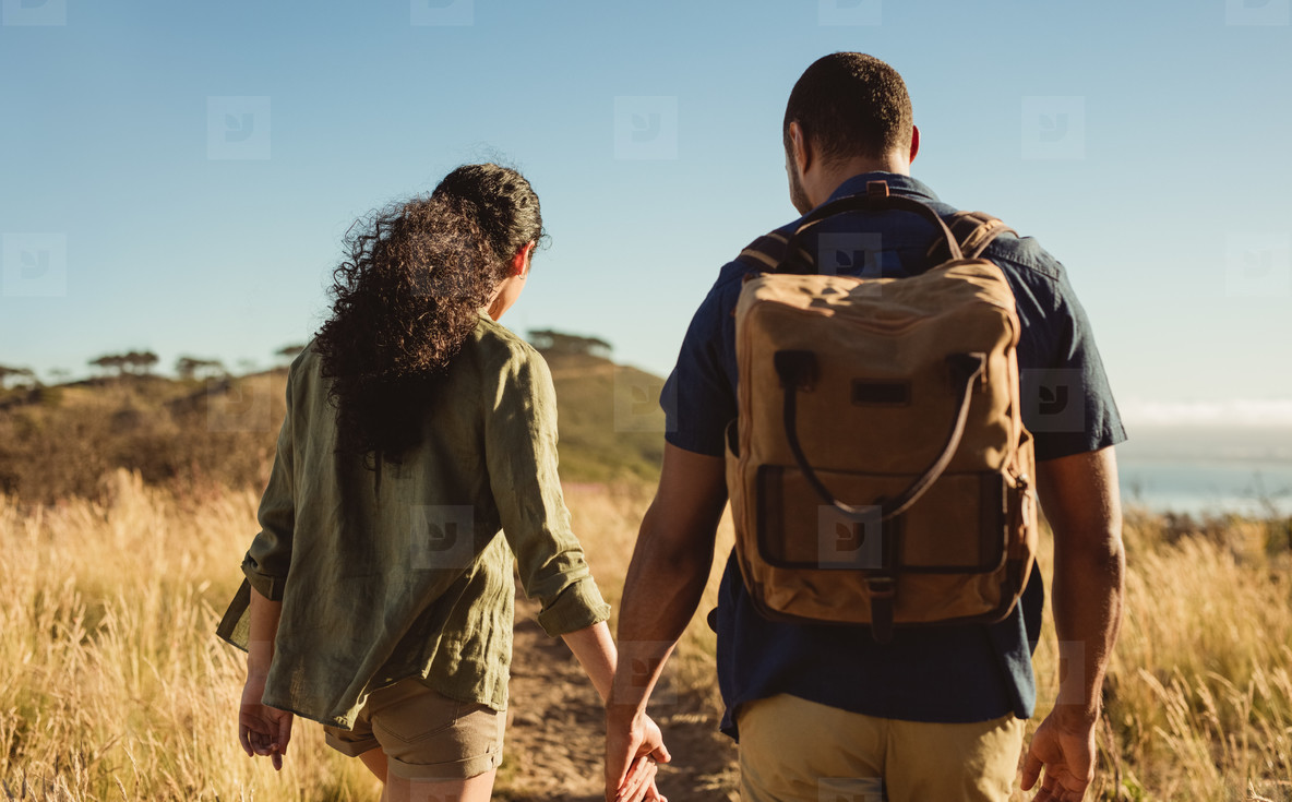 Couple walking on a hill