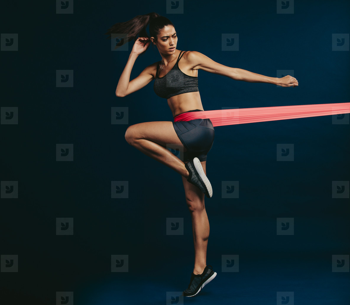 Healthy woman working out with resistance band