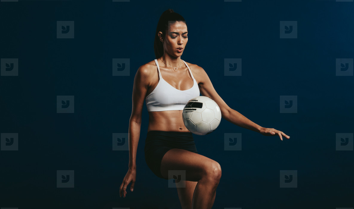 Female footballer concentrating on juggling techniques
