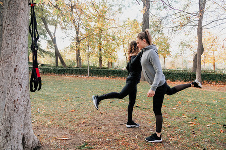 A couple of women training outdoors in the park