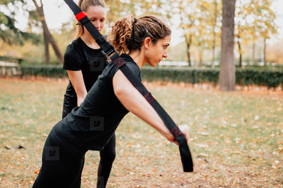 Women training together with trx