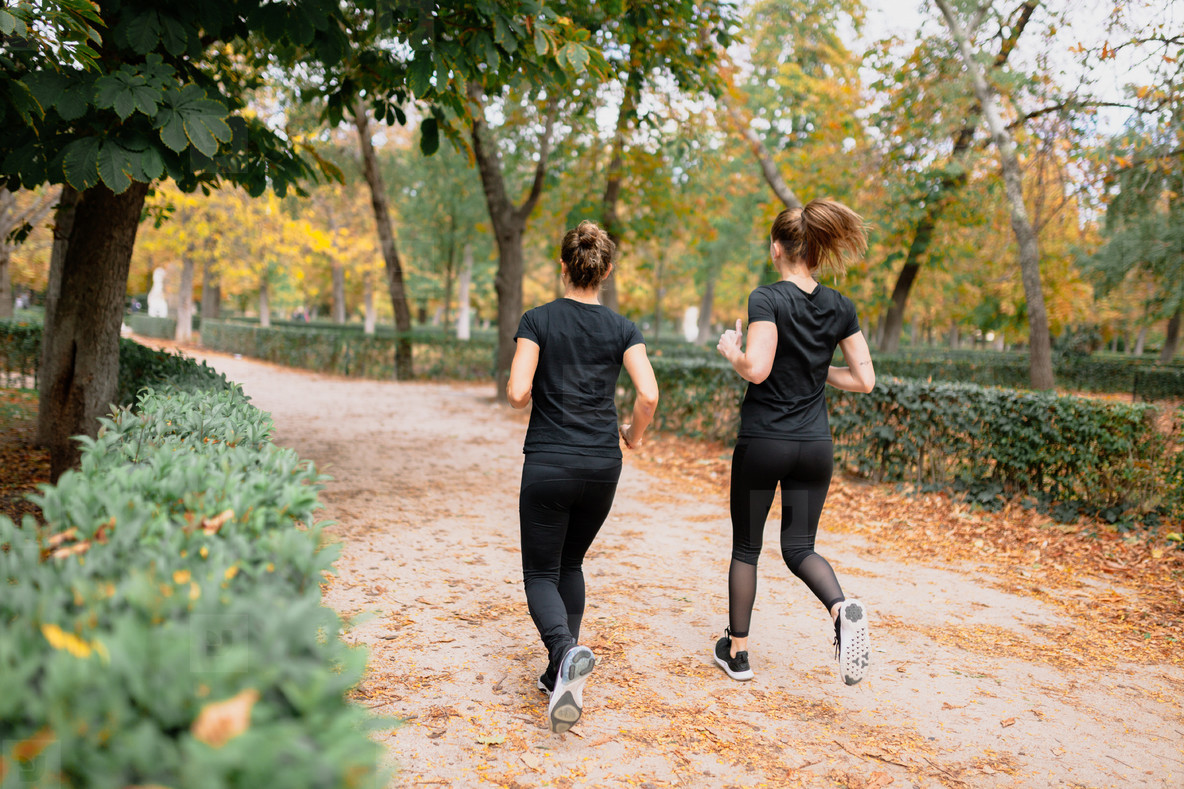 A couple of women running outsid