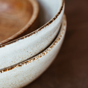 Macro abstract photography of modern minimalist ceramics set and wooden bowl