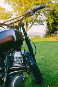 Custom motorcycle parked on the grass