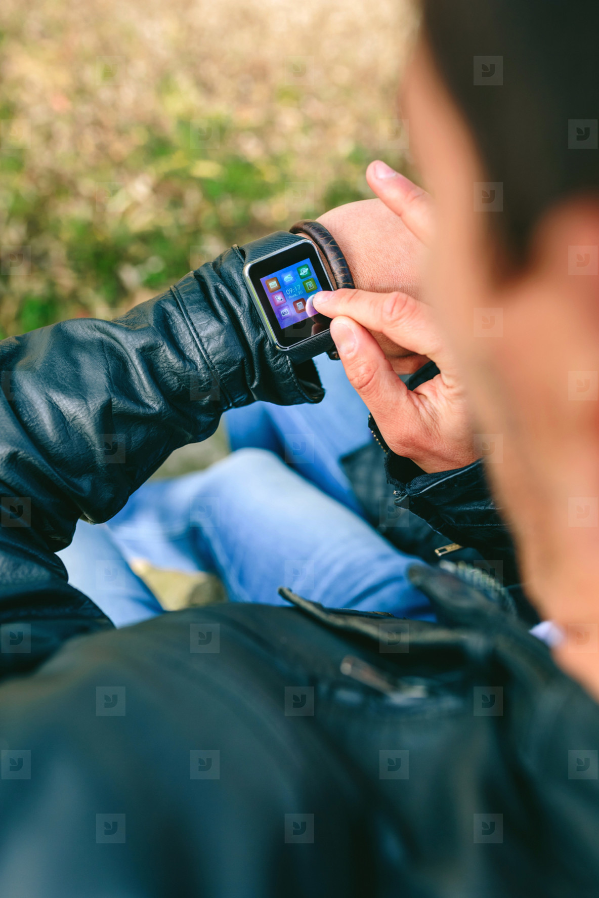 Unrecognizable young man using his smartwatch