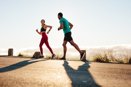 Fitness couple running on road