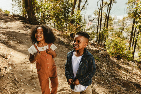 Beautiful two kids standing on a mountain trail