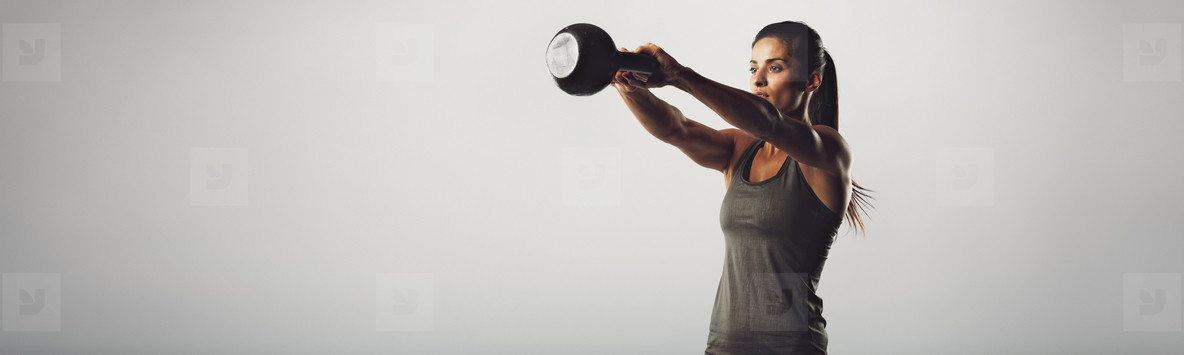 Kettlebell exercising woman