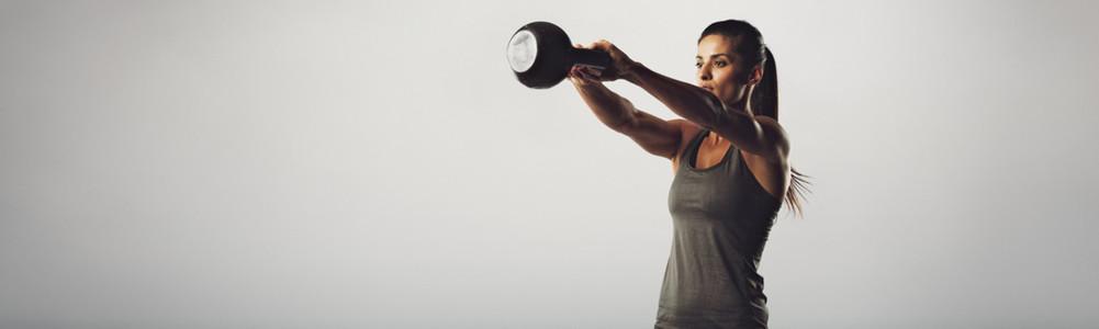 Kettlebell exercising woman