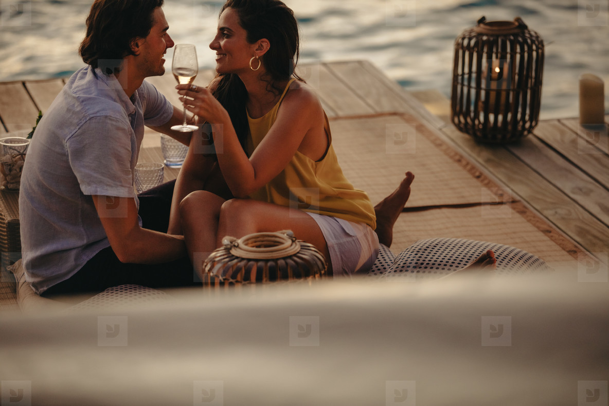 Romantic holiday on an overwater villa at sunset