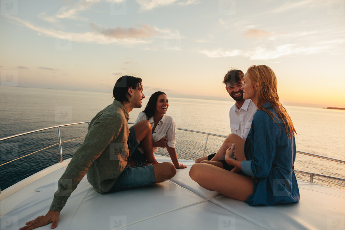 Friends on a holiday sitting on a yacht
