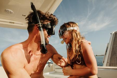 Father and daughter enjoying underwater adventure sport