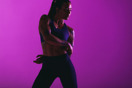 Fit woman doing warm up exercises