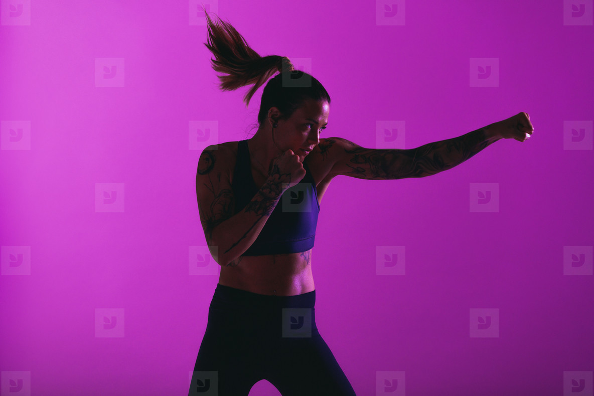 Fit woman practising punches
