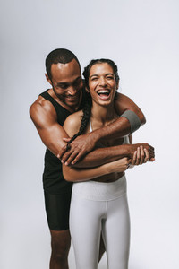 Portrait of fit couple having fun at workout