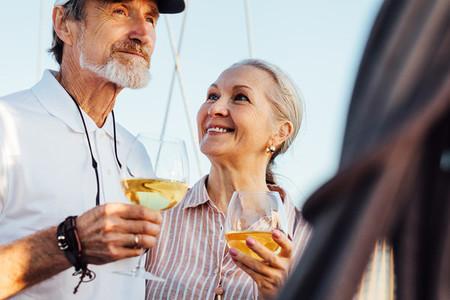 Mature couple drinking wine