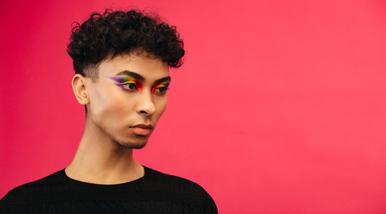 Gender fluid male with rainbow eye makeup