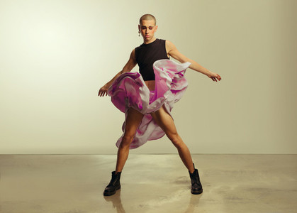 Cross dressed man dancing in studio
