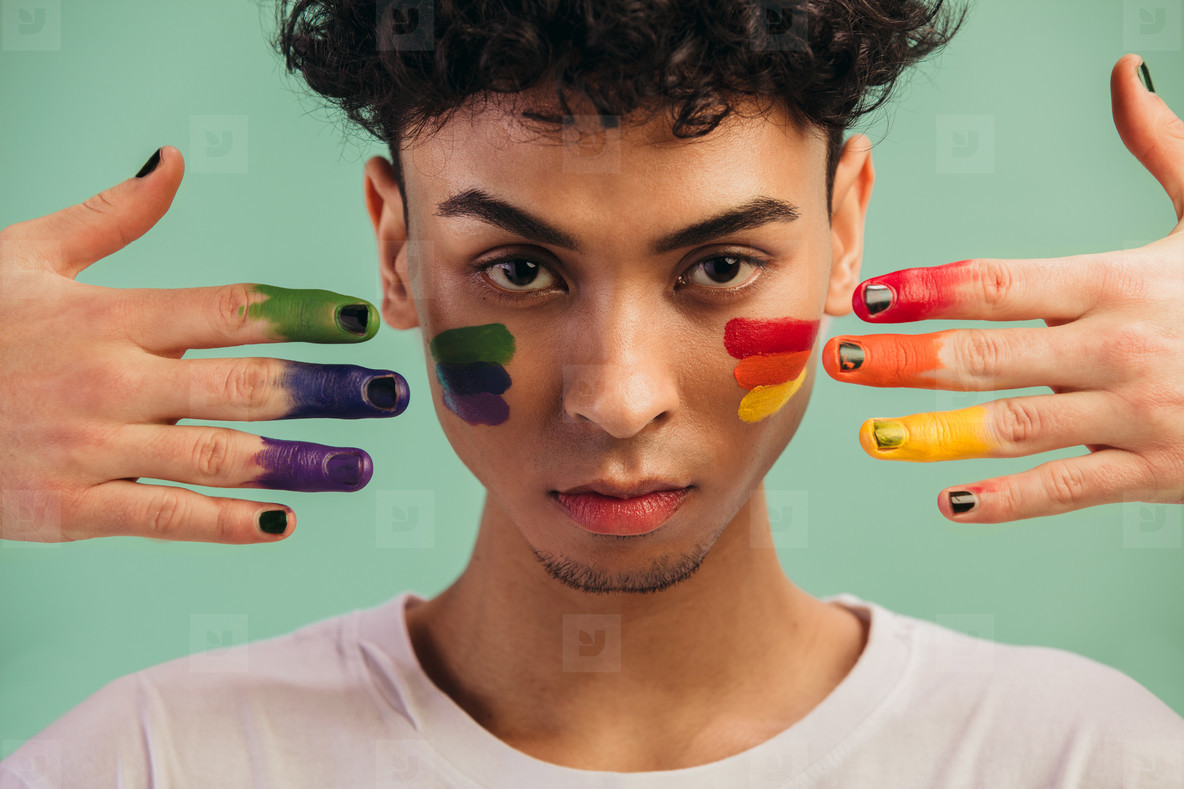 Man with LGTB flag colors painted on his face