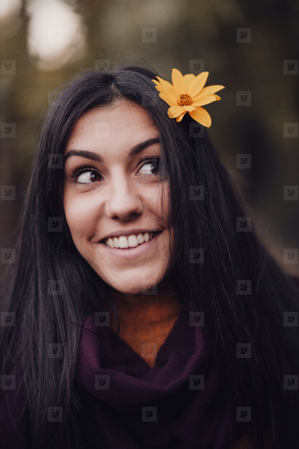 Woman portrait with yellow flower in her hair