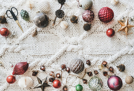 Flat lay of Christmas festive decoration toys over woolen background