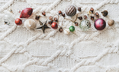 Christmas festive decoration toys and balls over woolen background