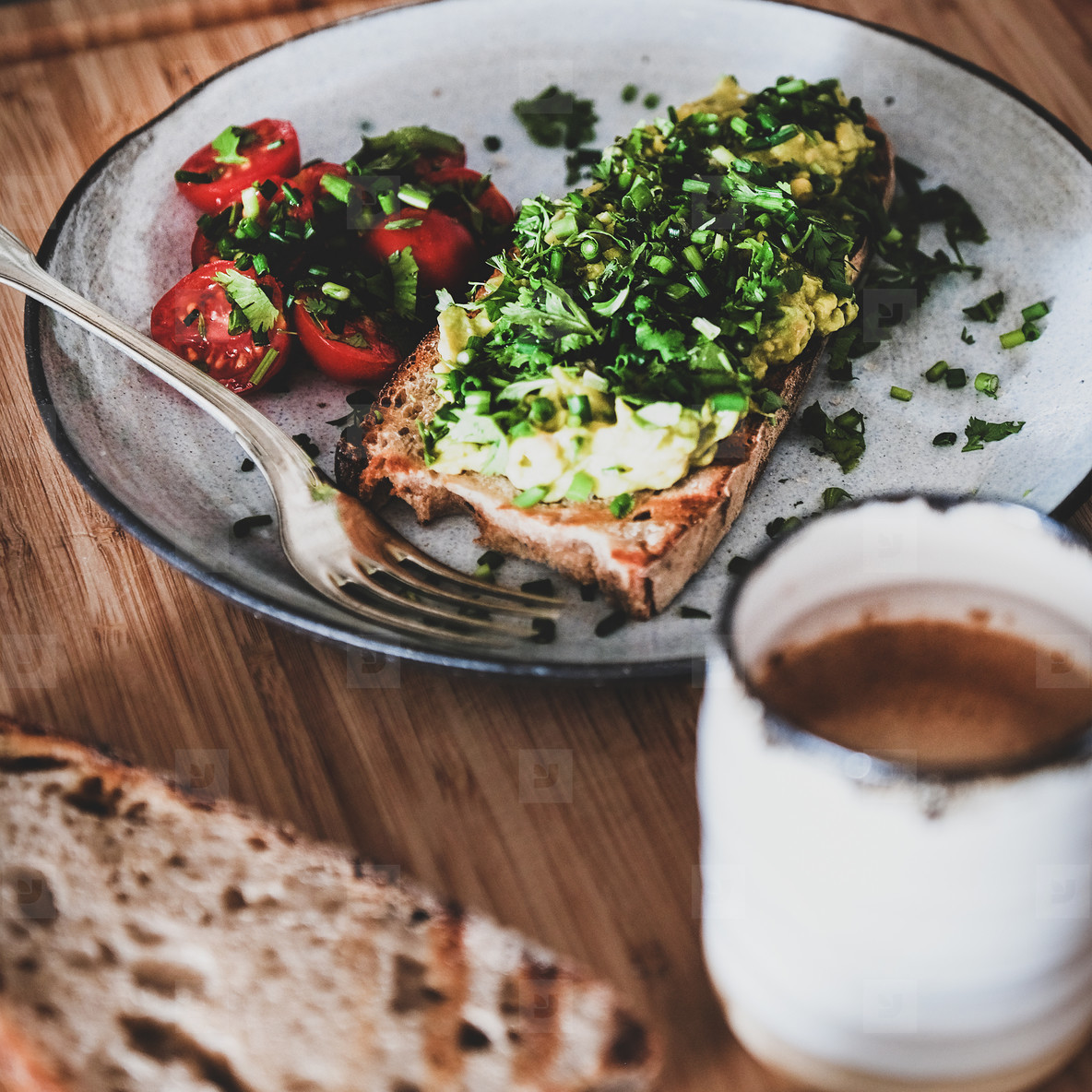 Healthy breakfast with avocado toast and coffee  square crop